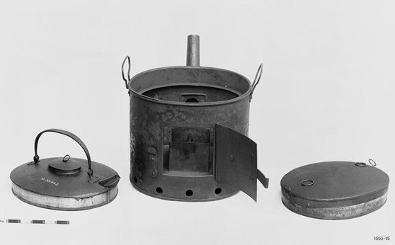 Black and white photograph of a metallic steam kettle
