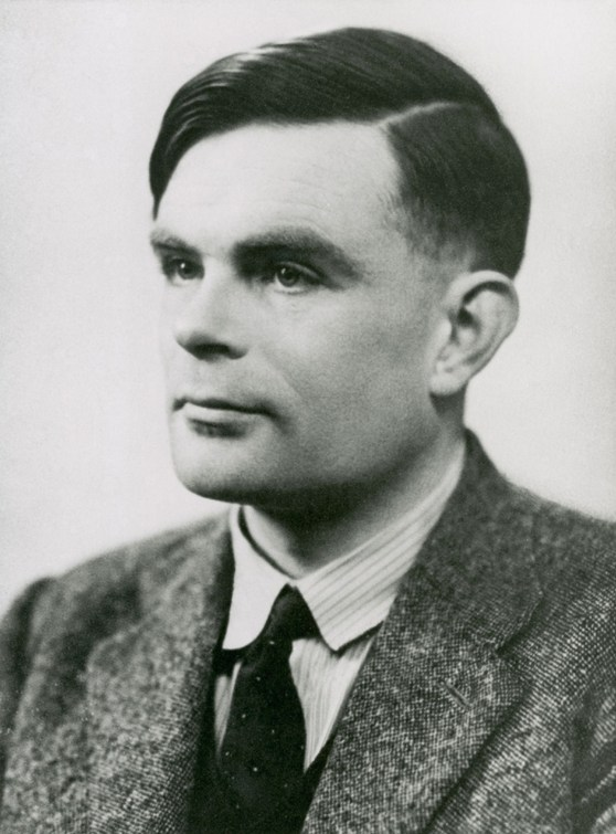 Black and white photograph portrait of Alan Turing looking to right of camera