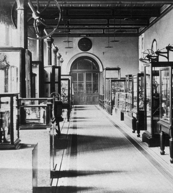Black and white photograph showing a very early exhibition of scientific instruments at the Science Museum, London
