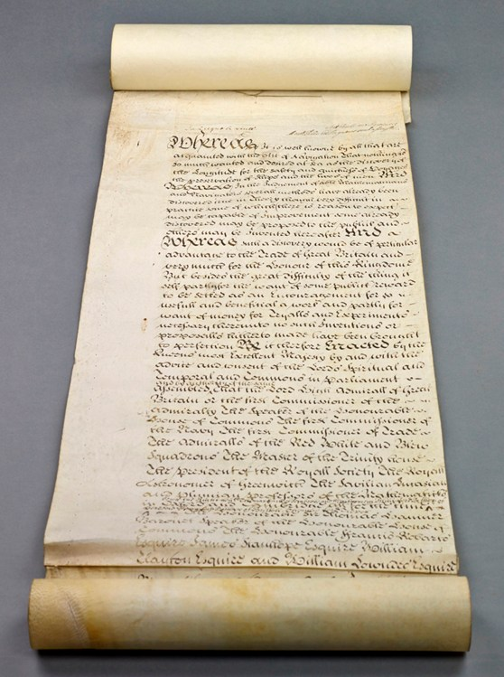 Old  legal document scroll showing calligraphic writing in old English