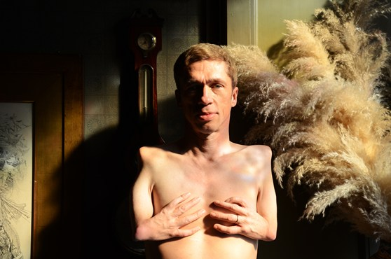 Colour photographic portrait of actor and musician Mat Fraser