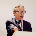 Colour photograph of Mat Fraser speaking into the microphone