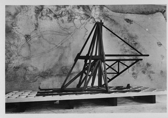 Black and white photograph of a large wooden model of a canal excavating machine