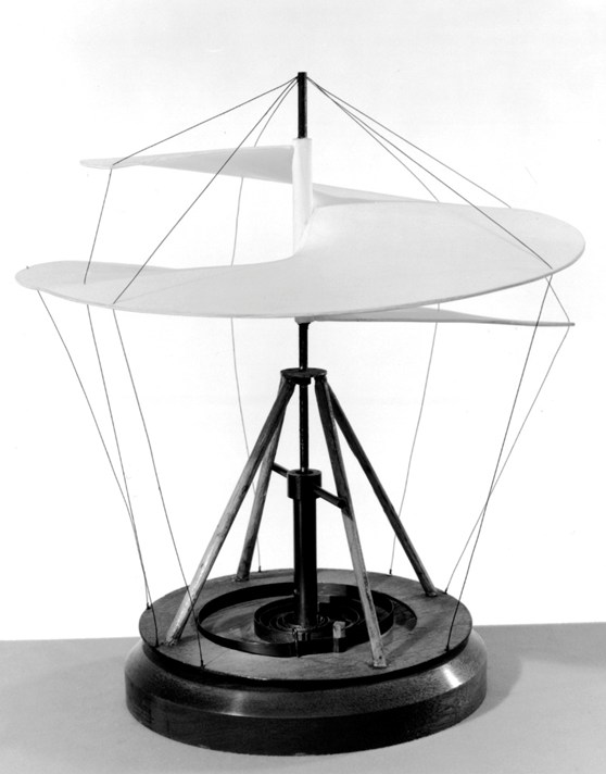black and white photograph of a working model of a static helicopter sail on a wooden base