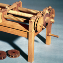 Colour photograph of a working wooden model of a machine for cutting wooden screws