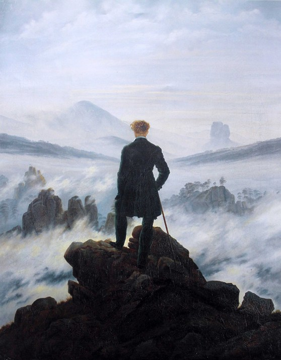 Oil painting from 1818 of a man standing atop a mountain and looking into the cloudy distance