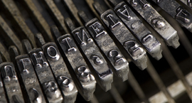 Close up colour photograph of the ink stamps of an old typewriter