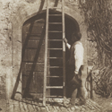 Early black and white photograph by William Henry Fox Talbot of a ladder leaning against a building surrounded by three men