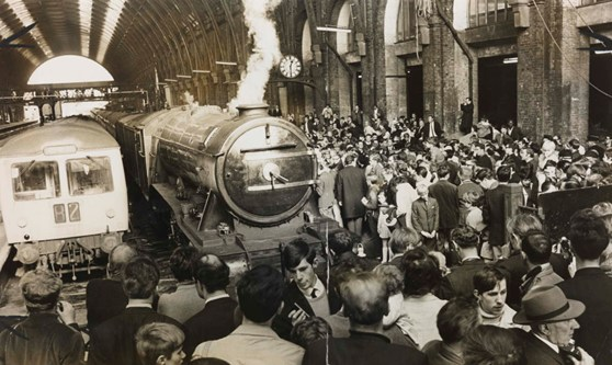 Black and white photograph of the Flying Scotsman steam train after restoration in London Kings Cross station in the 1960s