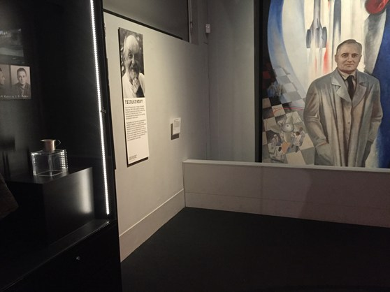 Colour photograph of a section of the Cosmonauts exhibition showing a painting of one of the Soviet designers
