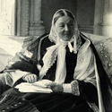 Black and white full figure seated portrait photograph of Florence Nightingale