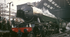 The Flying Scotsman steam train on the tracks at London Kings Cross station