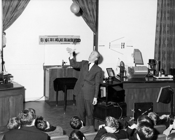 Black and white photograph of Major Wall giving a lecture demonstration to school children in 1969