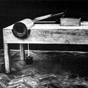 Black and white photograph of a wooden model of a design by Leonardo da vinci for testing friction