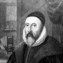 Black and white near full length portrait of John Dee holding a scroll