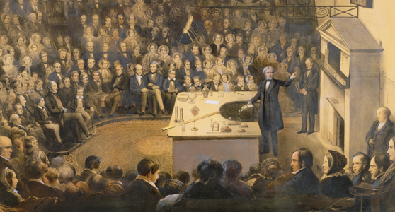 Coloured lithograph of Michael Faraday lecturing in the Theatre at the Royal Institution circa 1856