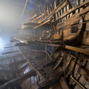 Colour photograph of the wreck of the Mary Rose ship during renovations