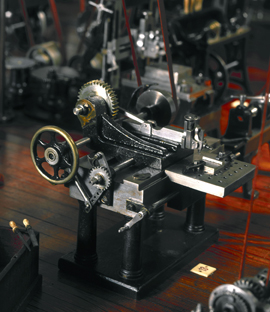 Colour photograph of detail of a miniature machine workshop model from late 1800s on display in the Science Museum London