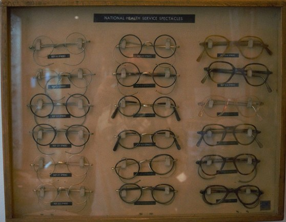 3c73921a9abd Colour photograph of a 1950 display case showing various styles of NHS  spectacles
