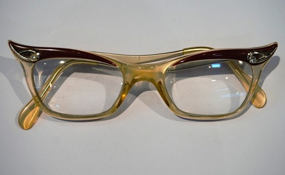 Colour photograph of a pair of hybrid Candida frame NHS spectacles