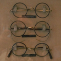Colour photograph of a 1950 display case showing various styles of NHS spectacles