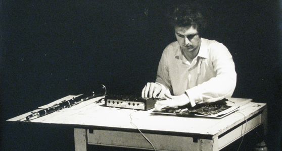 Black and white photograph of Hugh Davies with Shozyg I Uher mixer and clarinet pictured July 1968
