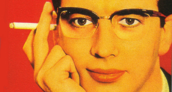 Colour print advertisement showing a man wearing Nylor supra frame spectacles and holding a cigarette