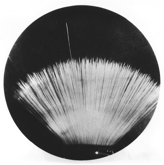 A black and white much magnified photograph from 1937 of a long range alpha particle