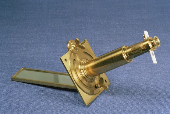 Colour photograph of a robustly made brass solar microscope