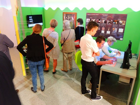 Colour photograph of museum goers at an exhibition about colour