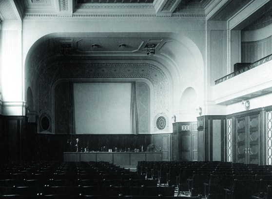 Black and white photograph of the interior of a large auditorium within a technical museum
