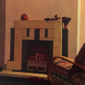 Colour photograph of a living room fireplace with a smokeless hearth