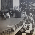 Black and white photograph from the World Power Conference of a large stage with seated presenters and a large seated audience