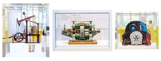 Colour photographs of a steam engine model a dial current generator and an internal combustion engine on display