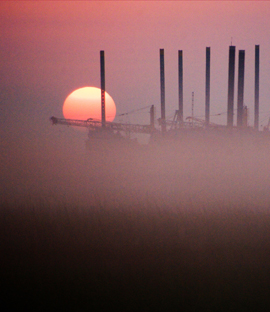Oil Rigs Silhouetted Against a Texas Sunrise