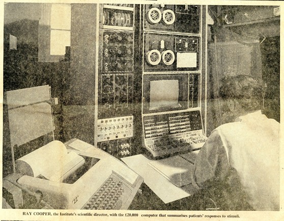 Newspaper clipping showing a scientist sitting before a computer from 1972
