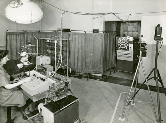 Black and white photograph of Janet Shipton with a six channel EEG in 1955