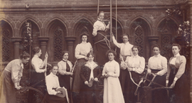 Sepia photograph of the Girton College Cambridge fire brigade featuring Hertha Ayrton from 1878