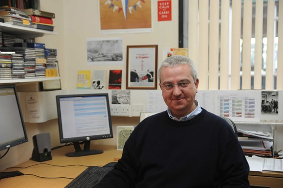 Colour photograph of Jeff Hughes in his office