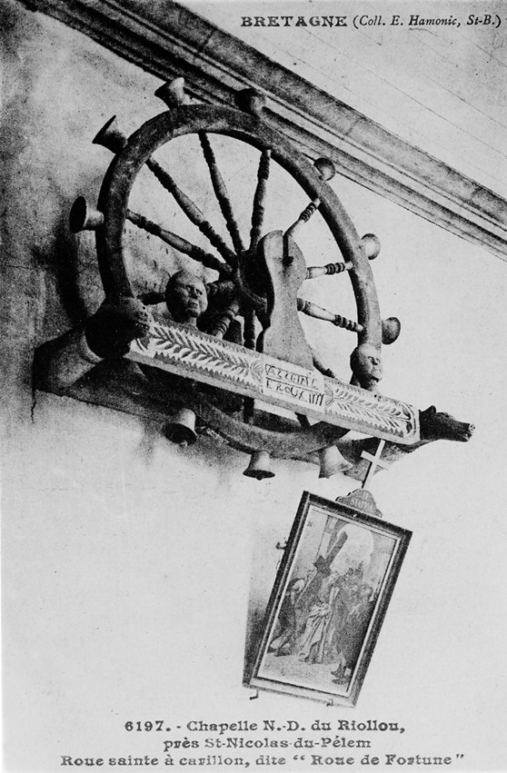Black and white photograph of a holy wheel of carillon hanging on a wall