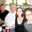 Colour photograph of Jeffs reading group sat inside a pub