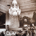 Black and white photograph of visitors in Harewood House music room alongside a modern colour photograph of the same room