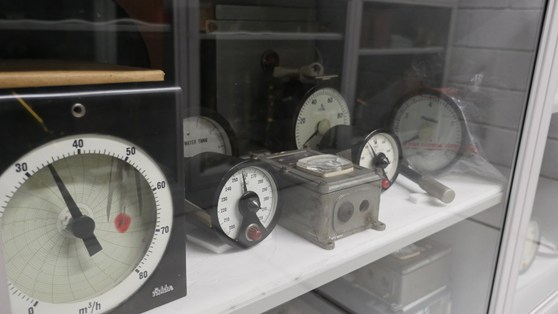 Colour photograph of a number of dials and meters in museum storage