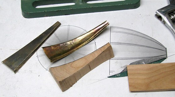 Colour photograph of strips of brass used to fabricate a mouthpiece