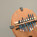 Colour photograph of a Kalimba instrument in a museum gallery
