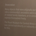 Colour photograph of a museum label explaining desecration