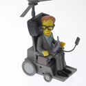 Colour photograph of a Simpsons style Stephen Hawking miniature model