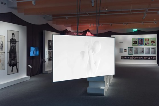 Gallery view of the Jo Spence exhibition showing a large video screen