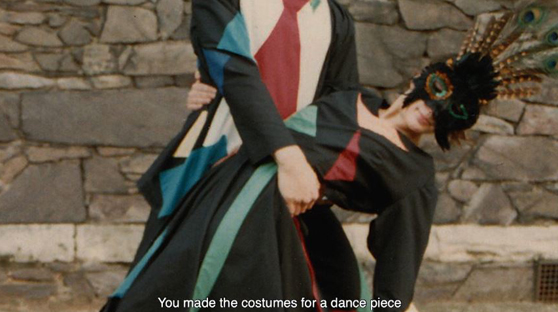 Video still of a couple ballroom dancing in costume