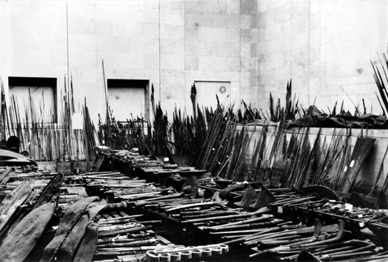 Black and white photograph of a cache of spears and swords